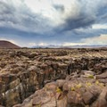 Red Hill cinder cone behind the canyon of the 40-foot dry falls.- Fossil Falls