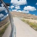 Racing down 18 Road for a lunch break.- 18 Road Mountain Bike Trails: Kessel Run