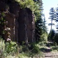Columnar basalt stands alongside the start of the trail.- Crabtree Valley Hike