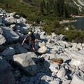 Scrambling through granite boulders on the way to Sapphire Lake.- Emerald + Sapphire Lakes