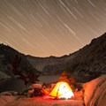 Reading beneath a star trail at Sapphire Lake.- Emerald + Sapphire Lakes