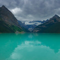 Lake Louise on a cloudy afternoon, but the water's still shining a bright green.- Lake Agnes + The Beehive Hike
