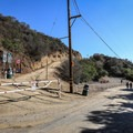 The trail splits with the Sunset Ranch property and begins climbing up fire roads.- Hollywood Sign via Hollyridge Trail