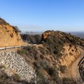 Winding climbs above the Los Angeles skyline.- Hollywood Sign via Hollyridge Trail