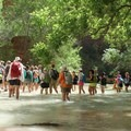 Hikers wading in the creek after leaving Mooney Falls.- Mooney + Beaver Falls Hike from Supai