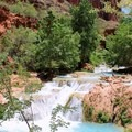 Cascading water at the confluence of Beaver and Havasu canyons.- Mooney + Beaver Falls Hike from Supai