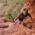 A hiker ascends the ladder.- Mooney + Beaver Falls Hike from Supai