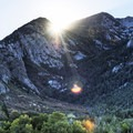 Morning sun popping out behind the cirque at 10,450 feet. - Bells Canyon Trail Hike