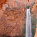 A view of Mooney Falls after emerging from the caves.- Mooney + Beaver Falls Hike from Supai