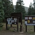 Signage information at Mirror Lake Campground.- Mirror Lake Campground
