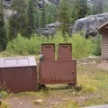 Vault toilets and bear-safe trash and recycling are provided at Lincoln Creek Campground.- Lincoln Creek Campground