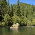 North Umpqua River flows next to Boulder Flat Campground.- Boulder Flat Campground