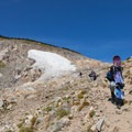 Snowboarders hike up to the glacier in the summer.- Saint Mary's Glacier + Saint Mary's Lake
