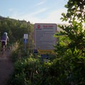 Top of the freeride section with warning signs.- Road to Arcylon Freeride Mountain Bike Trail