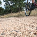 Pea-sized granite, mica, and feldspar cover the trail with pink and white hues.- Betasso Preserve Loop Mountain Bike Ride
