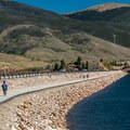 The path crossing the dam approaching Dillon.- Dillon Reservoir Recpath
