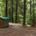 Vault toilets at the campground.- Stawamus Chief Provincial Park + Campground