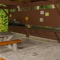 Basic shelter with a counter and tables. - Stawamus Chief Provincial Park + Campground