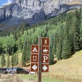 Signs at the trailhead parking lot.- Ice Lake + Island Lake Hike