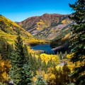 View of Maroon Lake from the trail.- Crater Lake + Maroon Lake Hike via the Maroon-Snowmass Trail