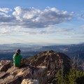 Contributor John Badila takes in the view at the summit of Mount Olympus.- Mount Olympus via Wasatch Boulevard Trailhead