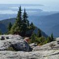 Exploring and enjoying the view. - Mount Seymour Summit Hike