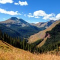 View of the creek and the road next to it from the mountains on the other side of the valley.- South Fork Mineral Creek