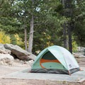 All sites have tent pads.- Aspen Meadows Campground