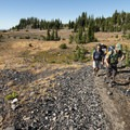 Obsidian sparkles as hikers travel south along the Pacific Crest Trail.- Chambers Lakes Hike via Obsidian Trailhead