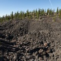Obsidian flow originating from the Collier Cone.- Eileen Lake + The Husband Lake Hike
