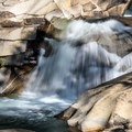 Many beautiful cascades tumble down the gorge- The Grottos Hiking Trails
