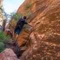 Scrambling down into the canyon.- Fins N Things Canyoneering