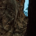 The downclimb chimney in the narrows, a potentially tricky spot.- Fins N Things Canyoneering