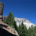 A pillar with the summit of Sawtooth Mountain in the background.- Sawtooth Mountain + Indigo Lake Hike