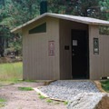 Well maintained park facilities include vault toilets.- Buffalo Campground