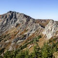 A view of the ridgeline of Whittier Peak as seen from the Mount Margaret Trail.- Whittier Ridge Trail from Norway Pass