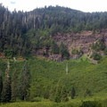 The trail climbs beside this huge, cliff-rimmed basin.- Middle Pyramid Hike