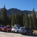 Parking lot, looking up at Devil's Castle (10,800 ft).- Cecret Lake