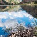 Beaver lodge on the shore of the lake.- Sylvan Lake Loop Trail