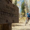 Climbing past the Big Water Trail marker as you approach Dog Lake.- Dog Lake Mountain Bike Ride: Great Western Trail to Big Water Trail