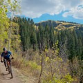 Mountain view as you descend.- Dog Lake Mountain Bike Ride: Great Western Trail to Big Water Trail