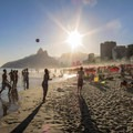 Sunset at Ipanema Beach with the Dois Irmãos (Two Brothers) Mountain in the distance.- Ipanema Beach