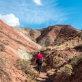 Leaving the wash, the trail winds through a maze of red hills.- Sound of Silence Trail