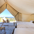 Inside one of the deluxe tents.- The Conestoga Ranch