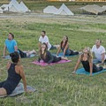 Yoga class on the lawn.- The Conestoga Ranch