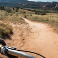 Riding over the plateau back to the exit.- Kokopelli Loops Mountain Bike Trails: Horsethief Bench