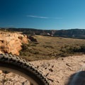 The majestic canyons sprawl out below.- Kokopelli Loops Mountain Bike Trails: Mary's Loop