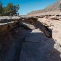 Giant cracks in the earth open onto vast canyons just ahead.- Kokopelli Loops Mountain Bike Trails: Steve's Loop