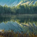 The lake is like glass in the morning.- Elsay Lake Hiking Trail