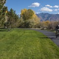 The pathway and park near the East Riverfront Trailhead.- Jordan River Parkway Road Cycling